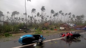 Damaged motorcycles lie on a road after Cyclone Fani made landfall in Odisha coast, India