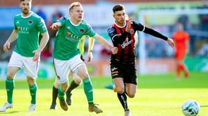 Daniel Mandroiu tries to get away from Conor McCormack at Dalymount