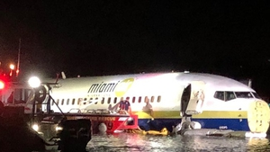The plane carrying 143 people slammed into shallow water in Jacksonville