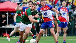 Aidan O'Shea battles for the ball with Matthew Queenan