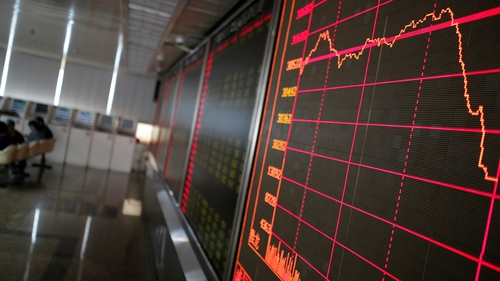 An electronic board displays the stock index at a securities brokerage house in Beijing