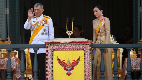 Monarch and new Queen Suthida greet people as the coronation draws to an end