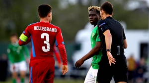 Festy Ebosele (C) was shown a second yellow card for making minimal contact with Czech captain Jan Hellebrand