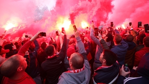 Liverpool have condemned a flag that was hung in the away end at Genk
