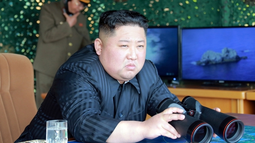 Kim Jong Un supervising an earlier 'strike drill' - reportedly testing long-range multiple rocket launchers and tactical guided weapons into the East Sea during a military drill on 4 May, 2019