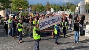 Several hundred members of the Beef Plan Movement protested over beef prices at the meeting