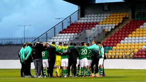 Ireland U17 gather in a huddle after their draw with Belgium