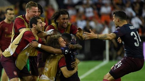 Arsenal's French striker Alexandre Lacazette (C) celebrates with teammates