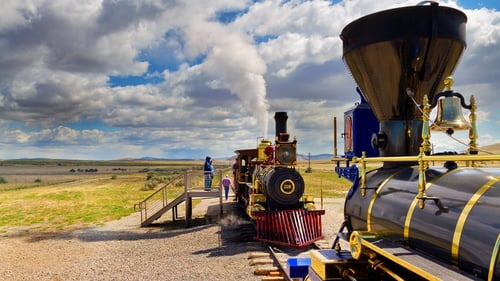 Two replica trains facing each other on railroad tracks at Golden Spike National Historic Site in Utah