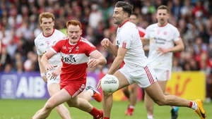 Derry's Conor McAtamney and Tiernan McCann of Tyrone battle for possession in their 2017 Ulster SFC clash