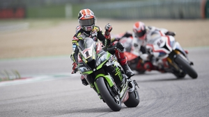 Jonathan Rea celebrates his victory at the iconic Imola track