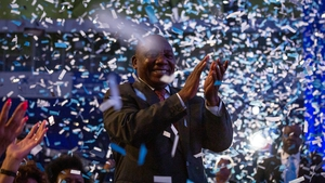 South African President Cyril Ramaphosa cheers during the results announcement ceremony