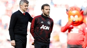 Ole Gunnar Solskjaer (L) and Juan Mata after United's defeat to Cardiff