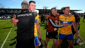 Clare management and players celebrate after beating Waterford