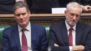 Labour shadow Brexit Secretary Kier Starmer (L) and party leader Jeremy Corbyn