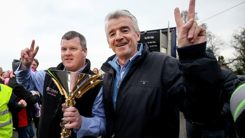 Gordon Elliott (L) and Michael O'Leary pictured with the Aintree Grand National trophy