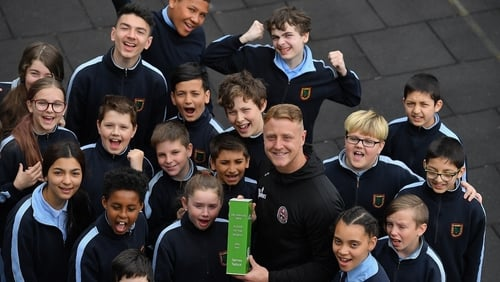 James Talbot collecting his award  alongside 5th and 6th class pupils at St Gabriel's School in Stoneybatter, Dublin