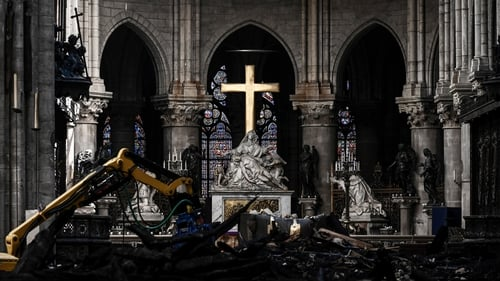Rubble and the cross at the altar inside Notre-Dame Cathedral, one month after it sustained major fire damage