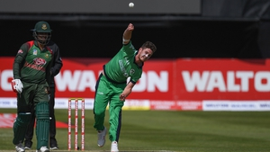 Mark Adair of Ireland bowls a delivery against Bangladesh