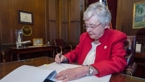 Governor Kay Ivey signing into law the Alabama Human Life Protection Act
