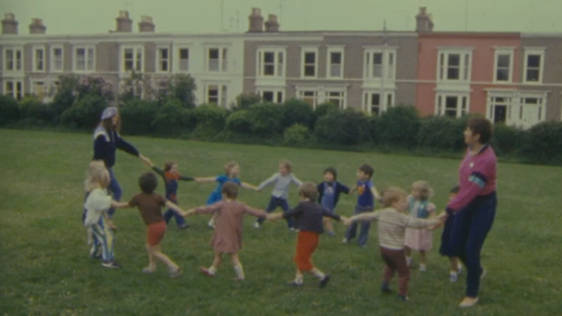 Children and teachers of Monkstown Naíonra playing in Belgrave Square (1984)