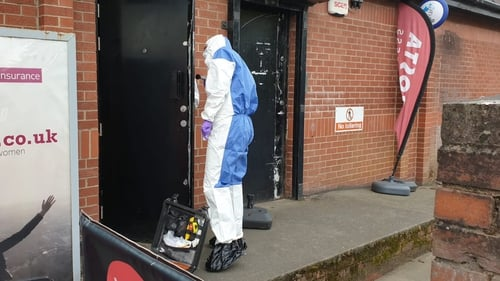 Forensic officers examine the scene in east Belfast