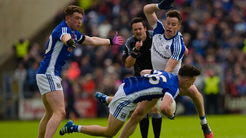 Cavan's Dara McVeety tackled by Fintan Kelly of Monaghan during the 2017 quarter-final clash between the sides