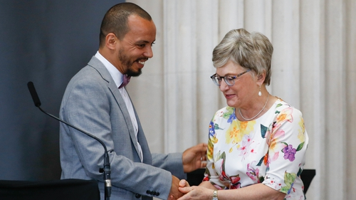 Minister Zappone presents gay rights activist Badr Baabou with his Frontline Defenders award