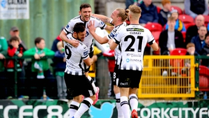 Dundalk players celebrate the opening goal at Turner's Cross