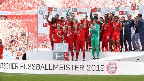 Franck Ribery of Bayern Munich lifts the trophy
