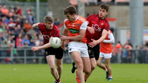 Down's Conor Maginn and Conor Poland with Ethan Rafferty of Armagh