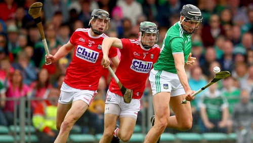 Mark Coleman gets a tackle in on Limerick's Gearoid Hegarty