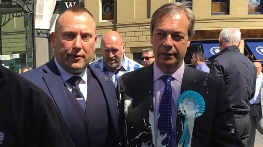 Man arrested after Nigel Farage covered in milkshake while campaigning