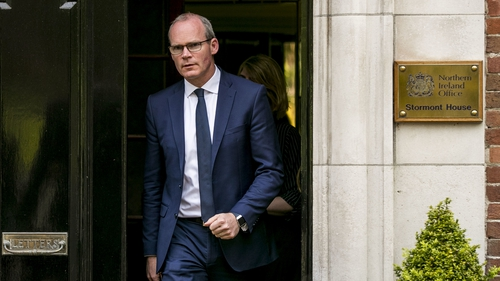 Simon Coveney also acknowledged that events at Westminster could prove a distraction for the Stormont process