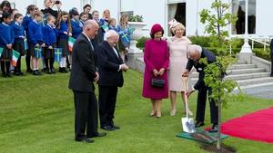 Michael D Higgins at Arás an Uachtarán watches King Carl XVI Gustaf plant a tree