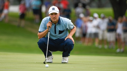 Jordan Spieth reads his putt on the sixth green