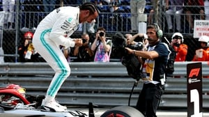 Lewis Hamilton celebrates after securing pole position ahead of the Monaco Grand Prix