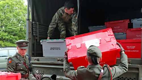 Members of the Defence Forces load ballots on to trucks at the RDS in Dublin for transport to other count centres