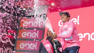 Richard Carapaz celebrates taking the leader's jersey