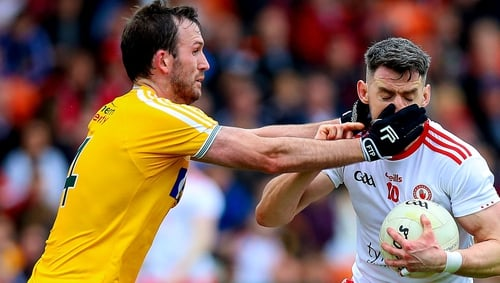 Mattie Donnelly tackled by Patrick Gallagher