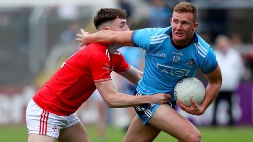 Ciaran Kilkenny evades Fergal Donohoe of Louth