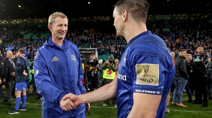 Leo Cullen congratulates captain Johnny Sexton following the victory at the home of Celtic FC