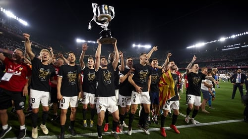 Valencia players celebrate with the trophy