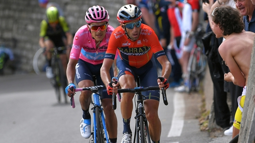 Race leader Richard Carapaz keeps a close eye on rival Vincenzo Nibali heading up the mountains on stage 15