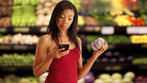 """Shoppers who look at their phones spend more time in the store, look at more products, and buy more things"" Photo: Shutterstock/Rocketclips Inc"