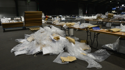 The clean-up operation begins in the RDS count centre in Dublin today