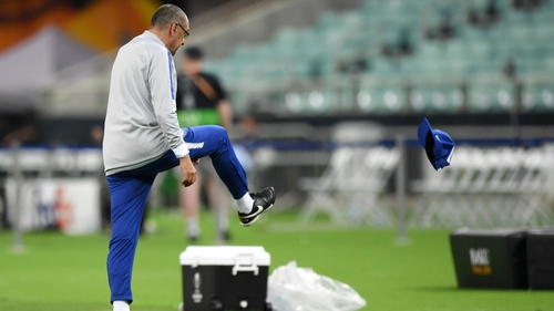 Maurizio Sarri kicks his cap in frustration during Chelsea training