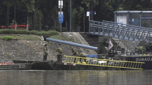 Soldiers take part in operation looking for survivors in River Danube in Budapest