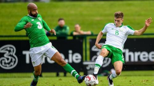 Republic of Ireland striker David McGoldrick in action against Jayson Molumby of Republic of Ireland U21s