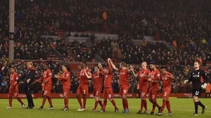 Jurgen Klopp leads his players towards the Kop after the 2-2 draw with West Brom on 13 December, 2015